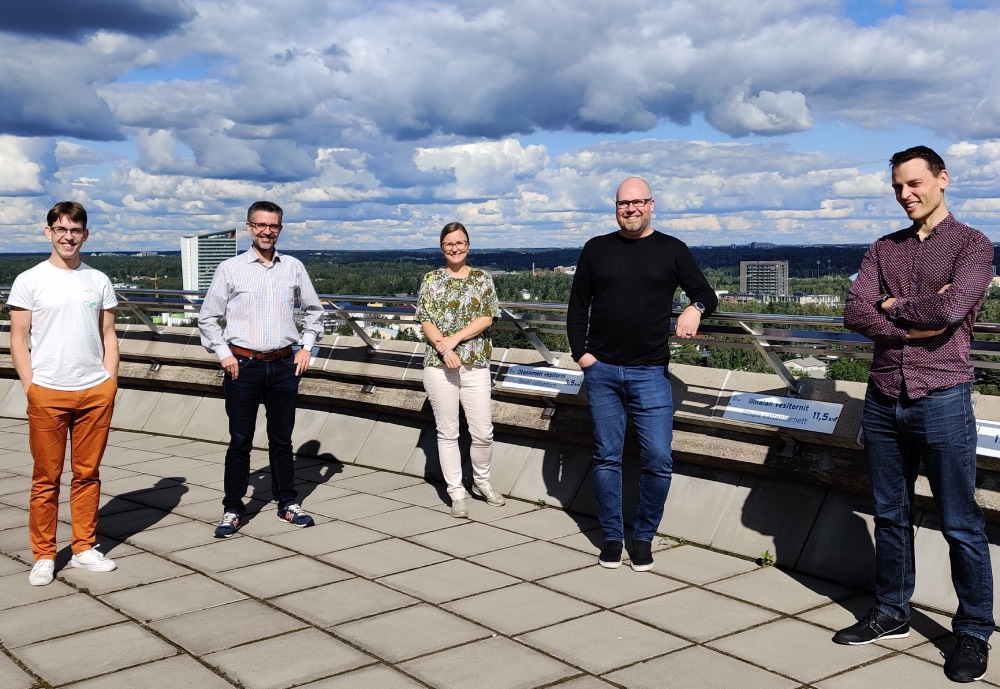 Taival team members on a rooftop