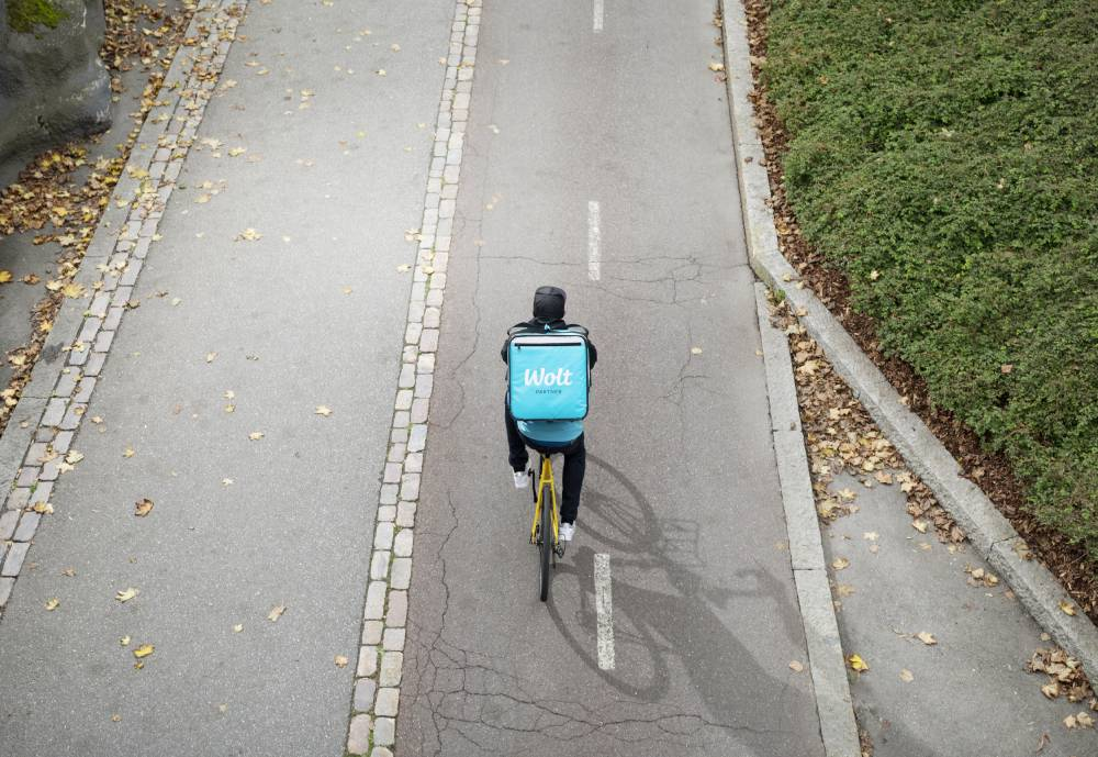 Wolt delivery person driving a bike