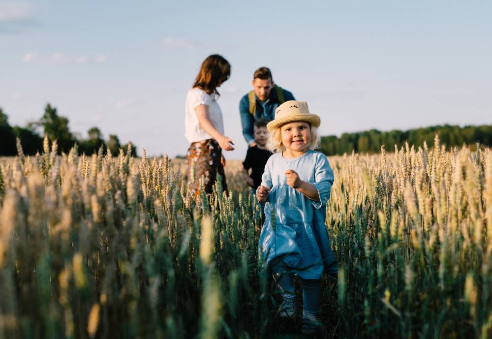 A child and her parents in a field