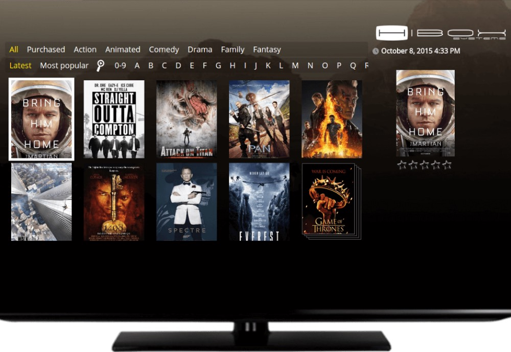 A TV with Hibox software and movies on display