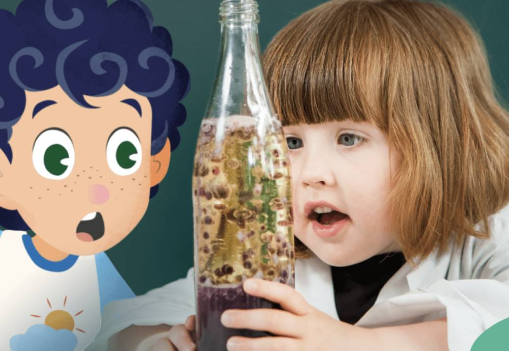 a young girl and cartoon boy looking at a bottle