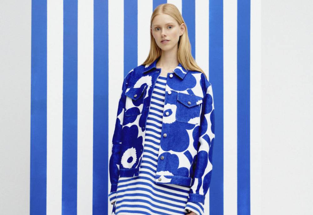 A model clad in a blue and white coat and dress