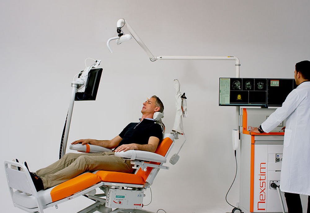 Man having a brain scan with a doctor observing