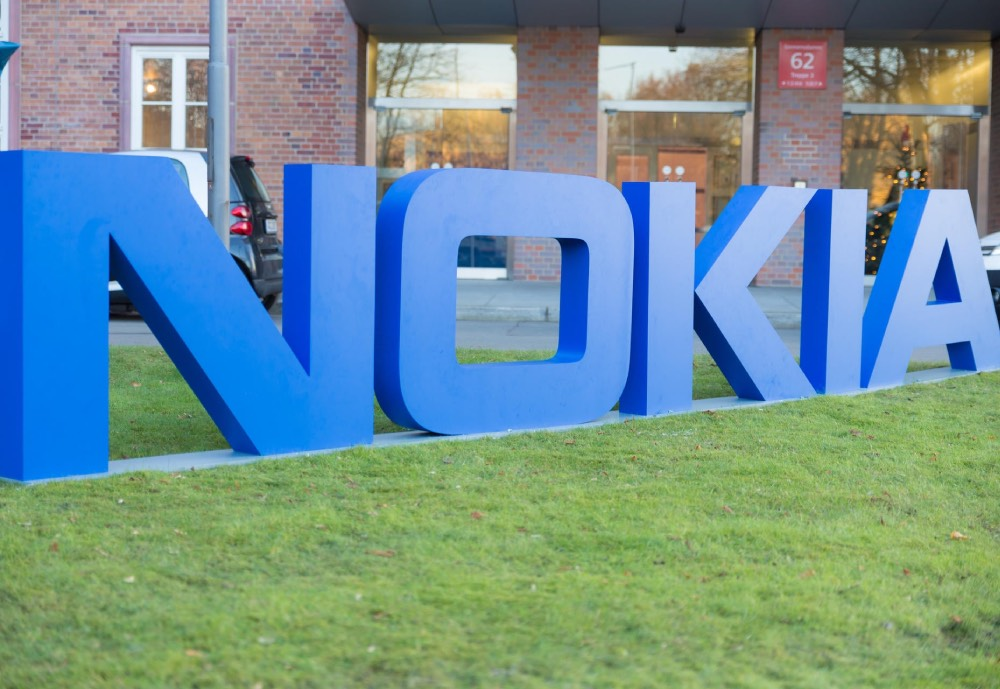 A Nokia sign with big letters on the ground