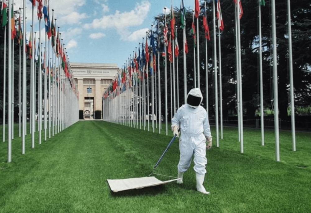 person in protective gear walking on grass