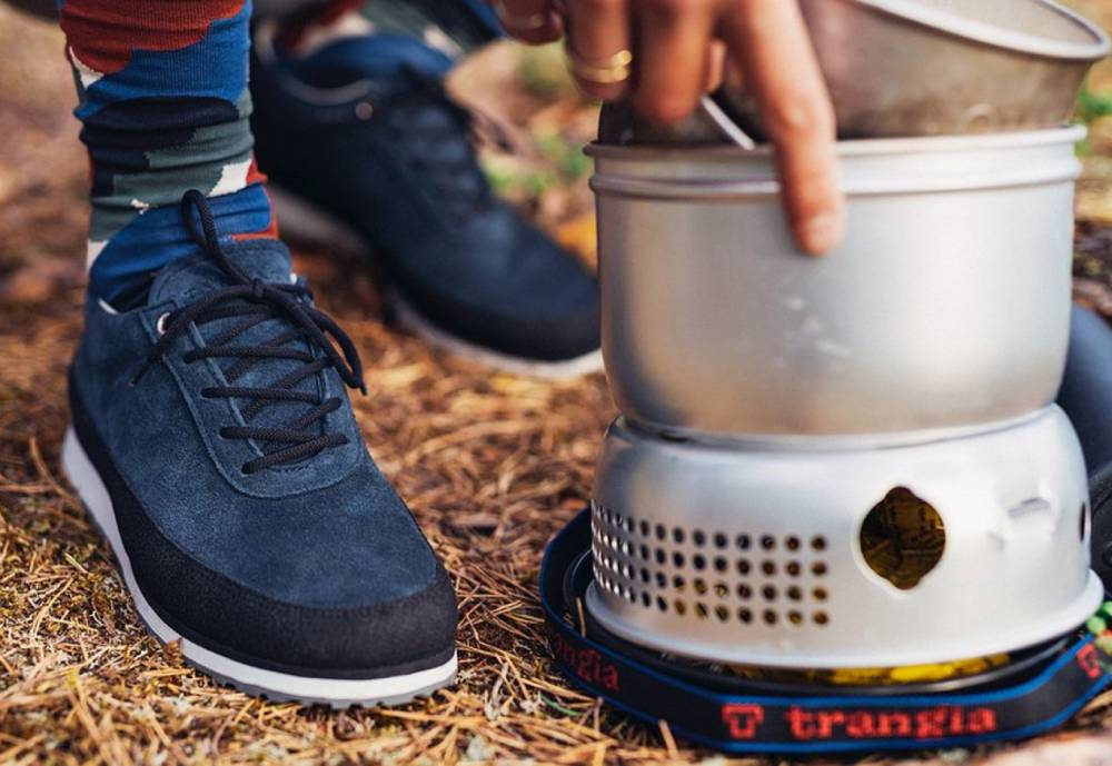 a pair of shoes and camping equipment