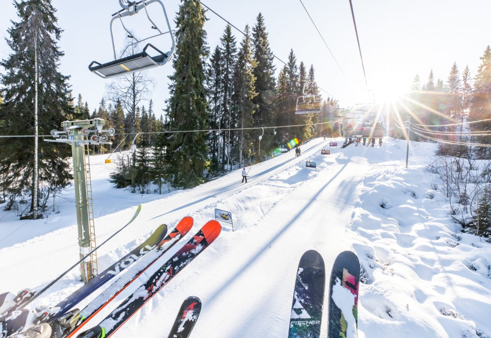 Skis above the slope on a skilift
