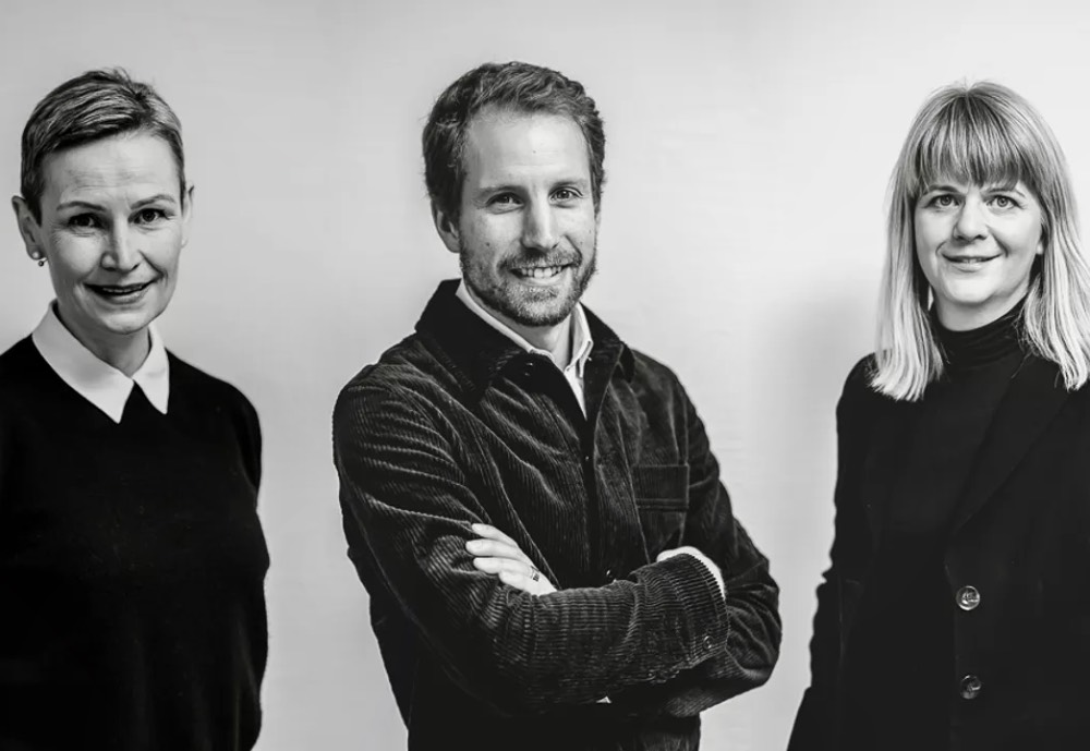 Cambri's three executives standing together in a black and white image