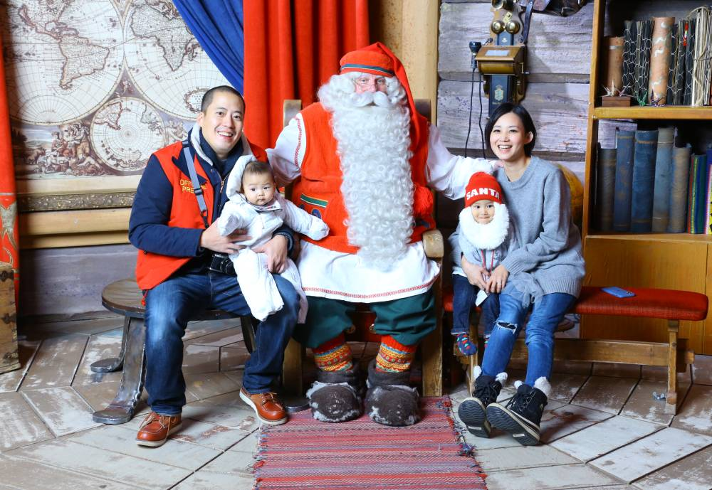 Ivy Chu and her family gathered around Santa Clause