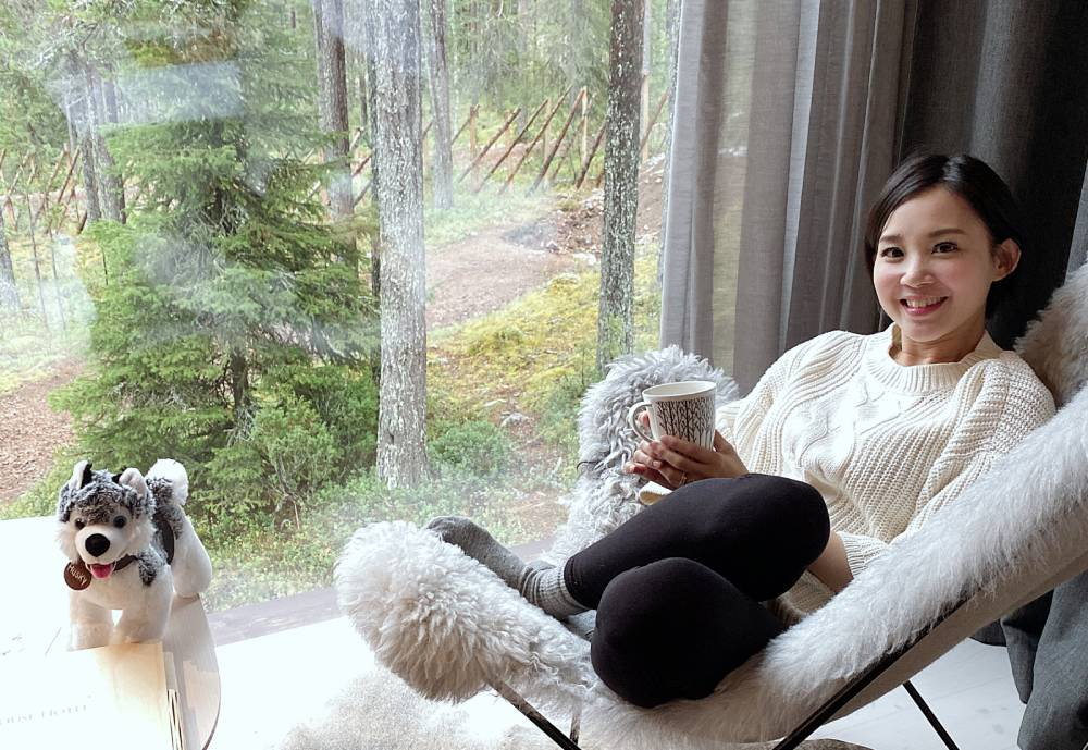 Ivy Chu relaxes on chair next to window