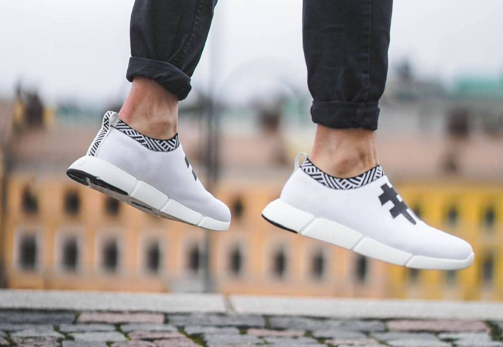 a person jumping with white sneakers