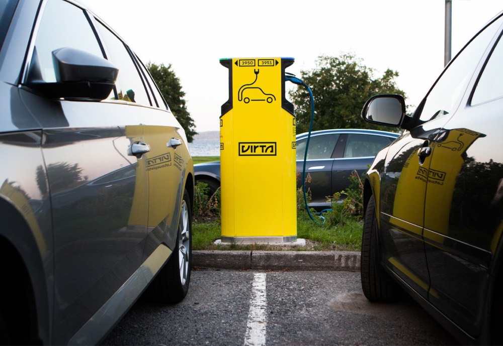 Two cars at an Virta electrical vehicle charging station