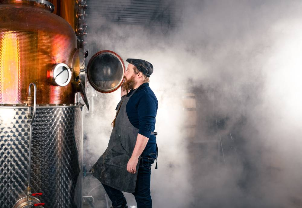man in distillery