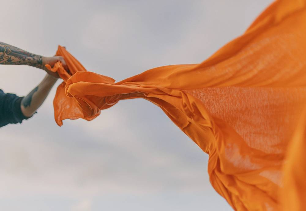 sustainable orange textile in the wind