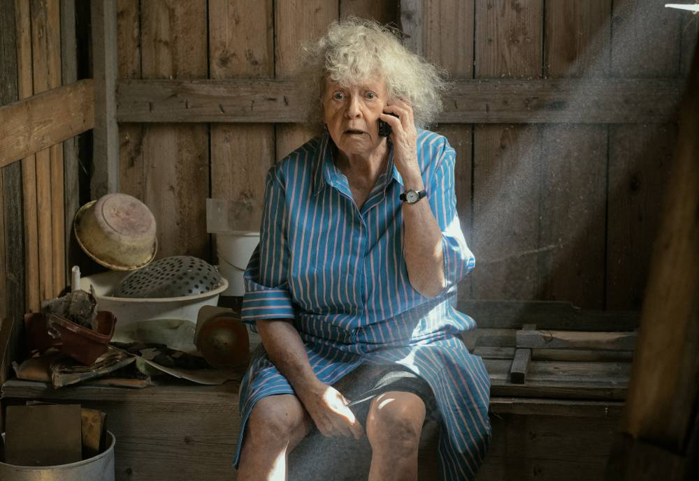 elderly woman speaking on a mobile phone