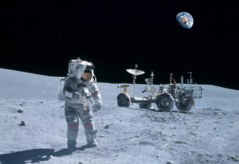an astronaut and buggy on the Moon