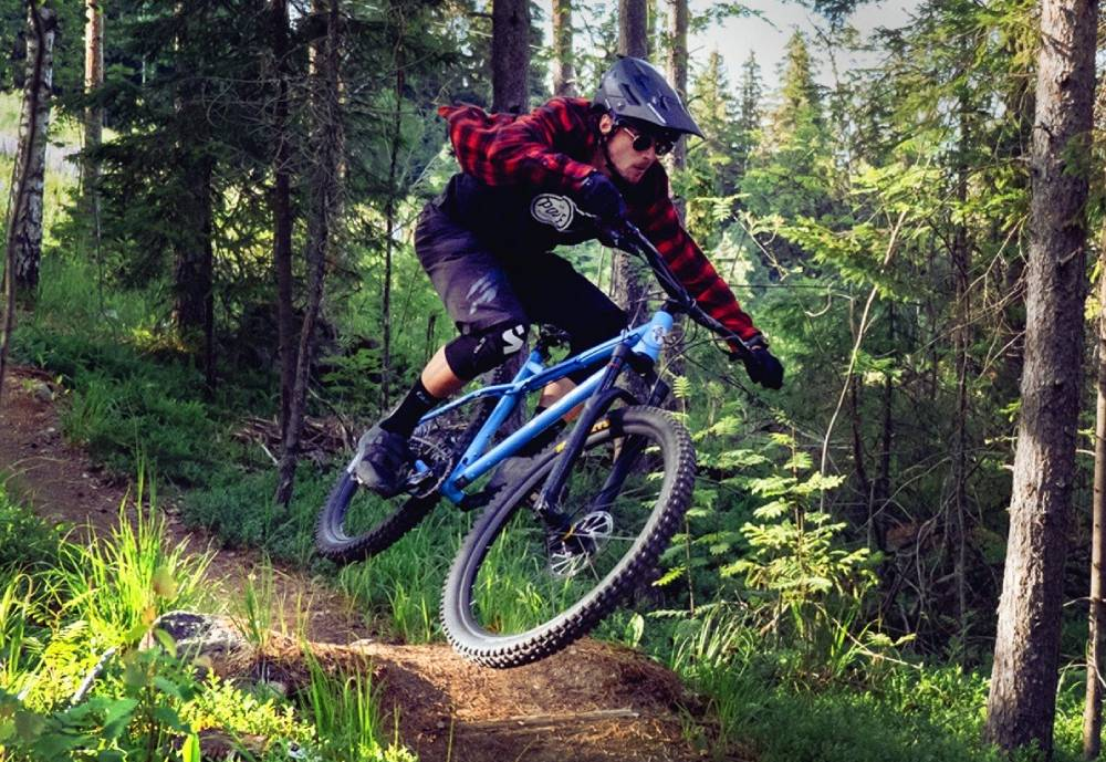 Mountain biker jumping in the forest