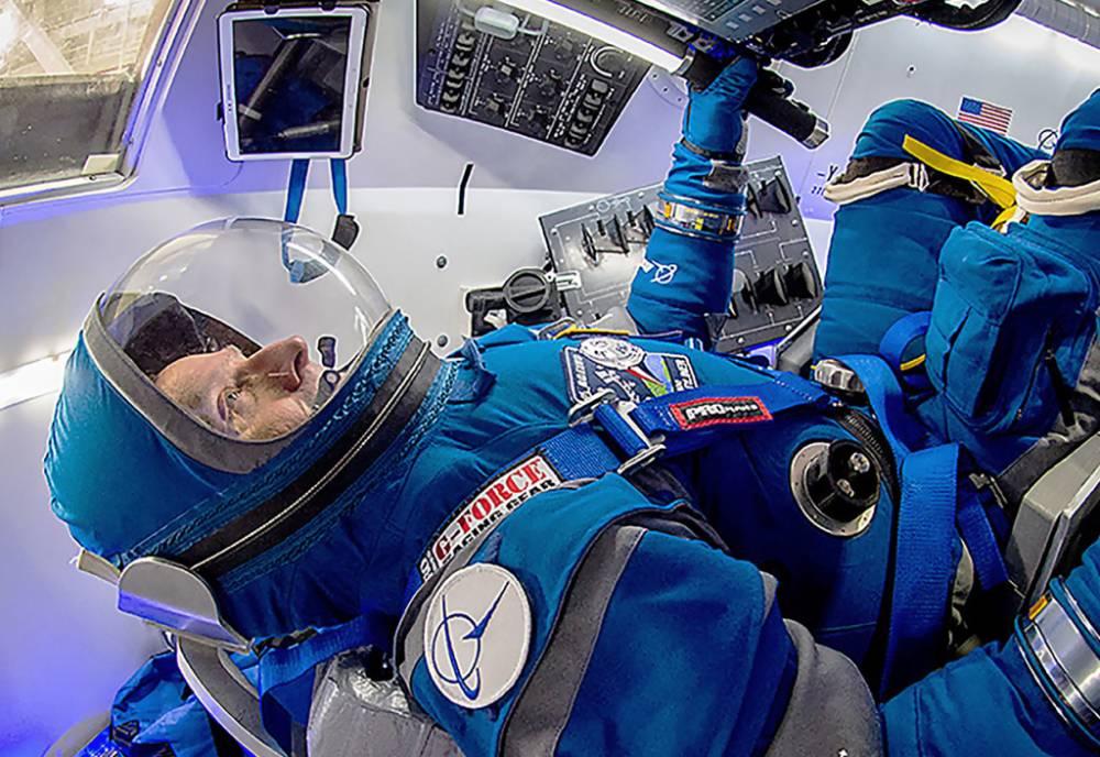 astronaut at the controls