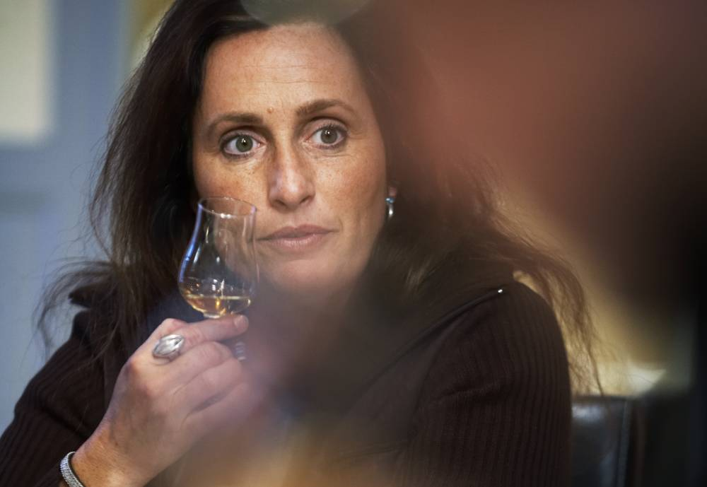 Angela D'Orazio, the master blender at Mackmyra, holding a copita nosing glass in front of her face.