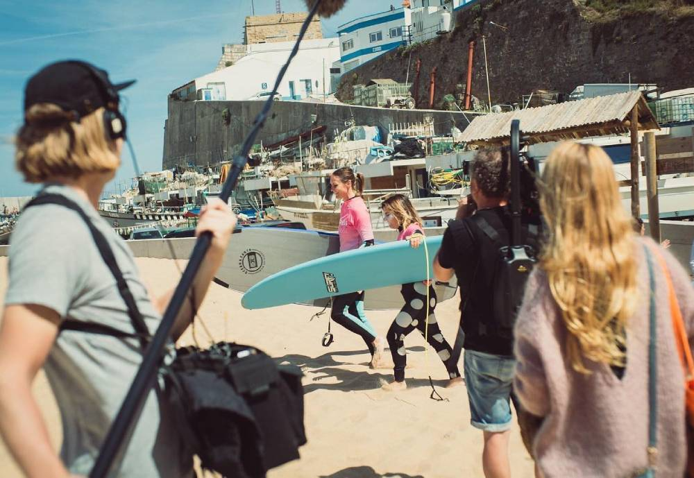 female surfers heading out in Ericeira