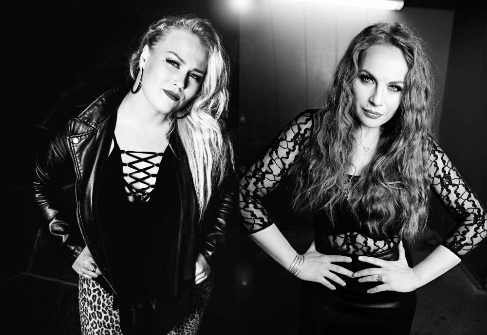 two female metal vocalists in black and white photo