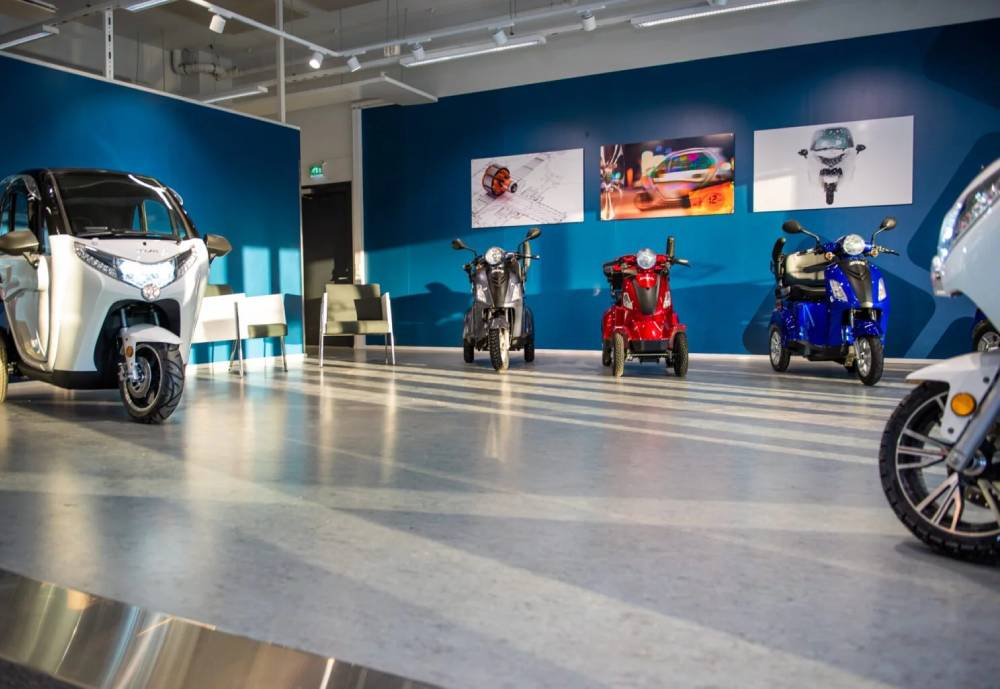 Light electric vehicles in a showroom.