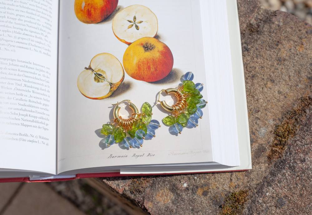 Annele jewelry on top of a book