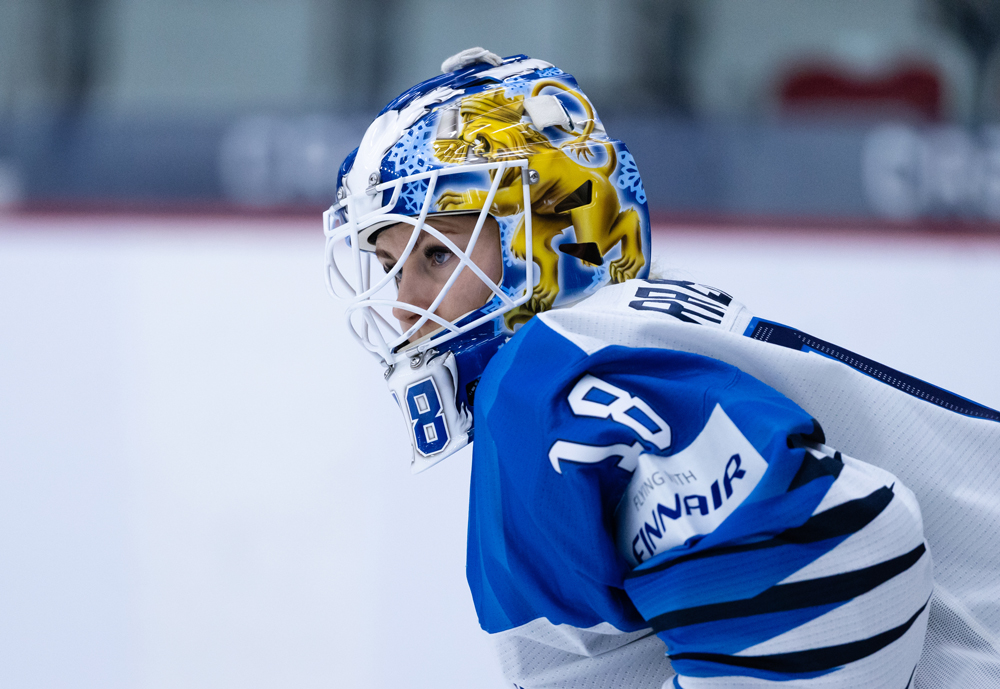 Finnish ice hockey player wearing a protective helmet